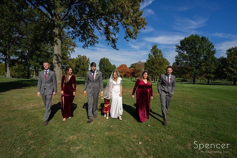 bridal party walking on golf course at Firestone