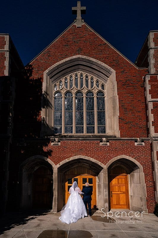 bride and dad waiting to enter wedding at St. Clare Church