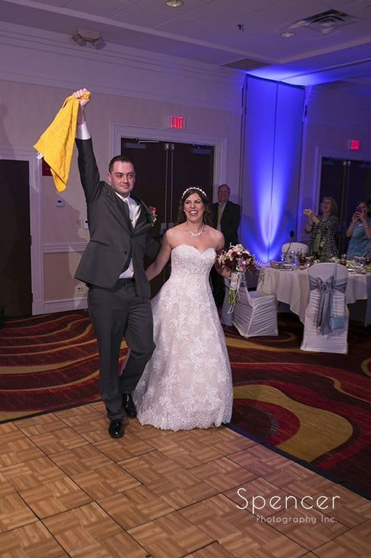 bride and groom entering their wedding reception at Embassy Suites Beachwood Ohio