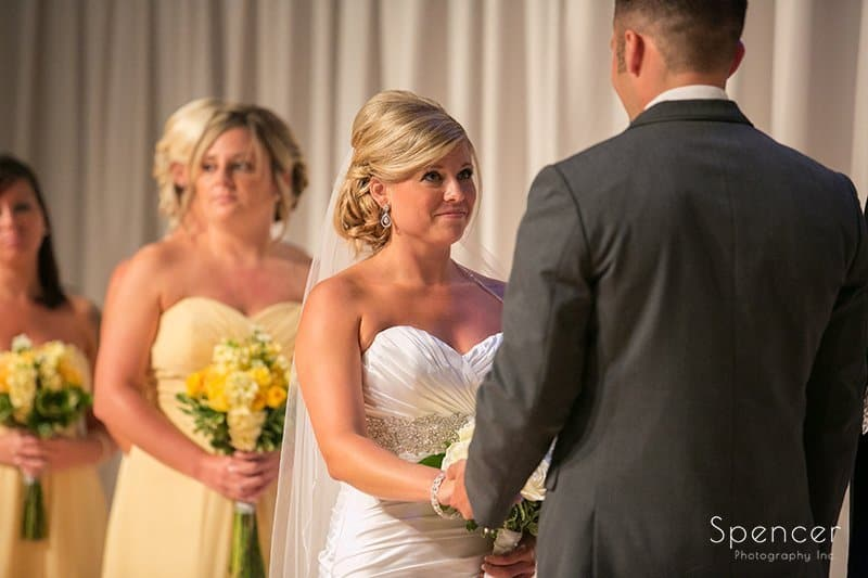 bride smiling at groom on wedding altar at Cuyahoga Valley Church