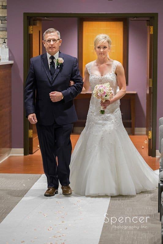bride walking down aisle at Canton Baptist Temple