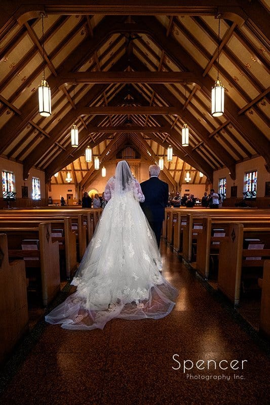 dad walking bride down wedding aisle at St. Clare Church