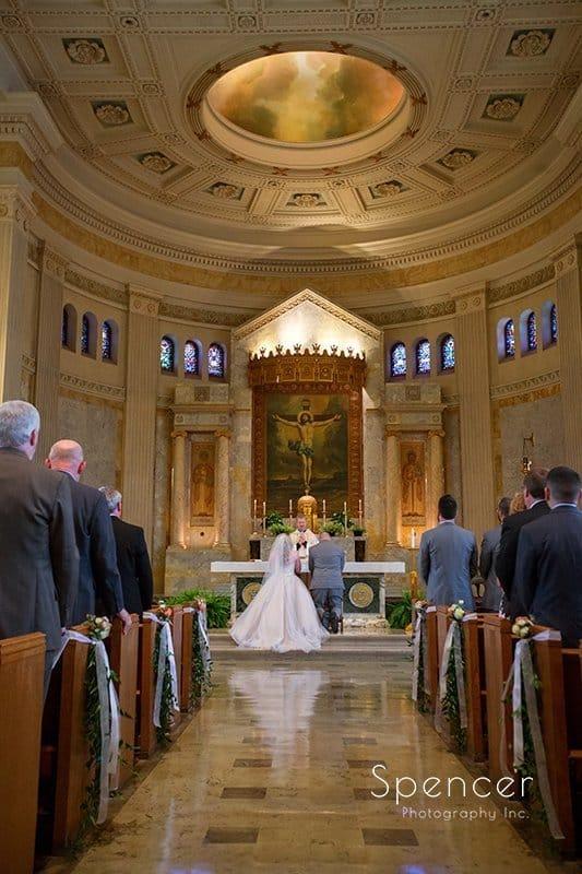 groom and bride finishing their wedding at Communion of Saints Parish