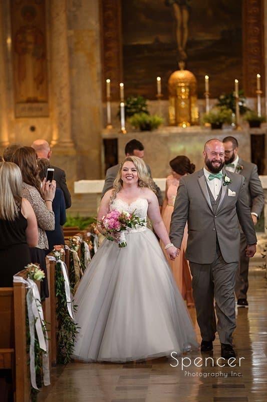 bride and groom recessional at Communion of Saints Parish