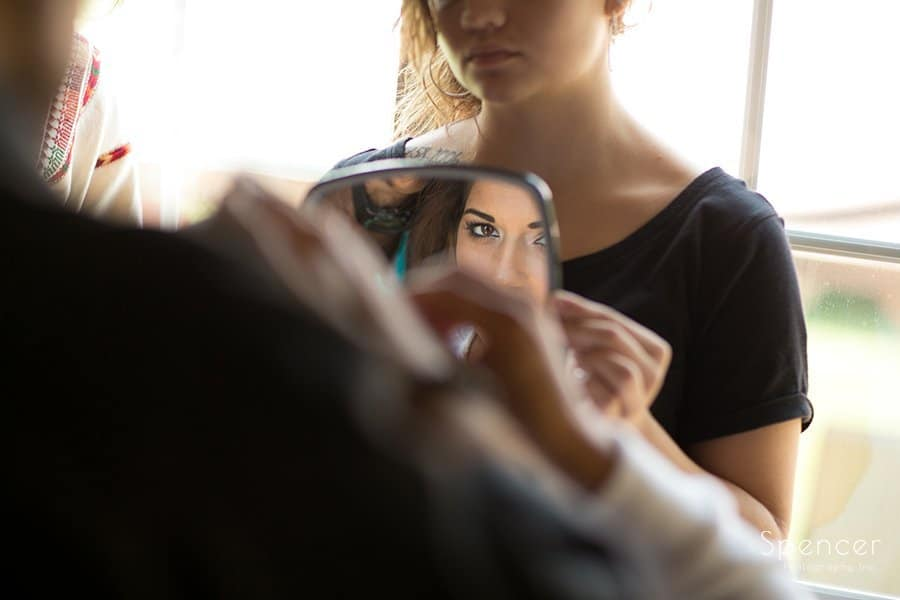bride checking make-up before Muslim wedding
