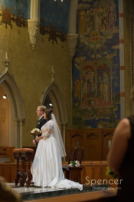 bride holding wedding bouquet at ceremony at Cathedral of St John the Evangelist