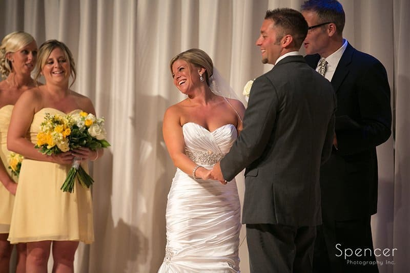 bride lauging at wedding ceremony at Cuyahoga Valley Church