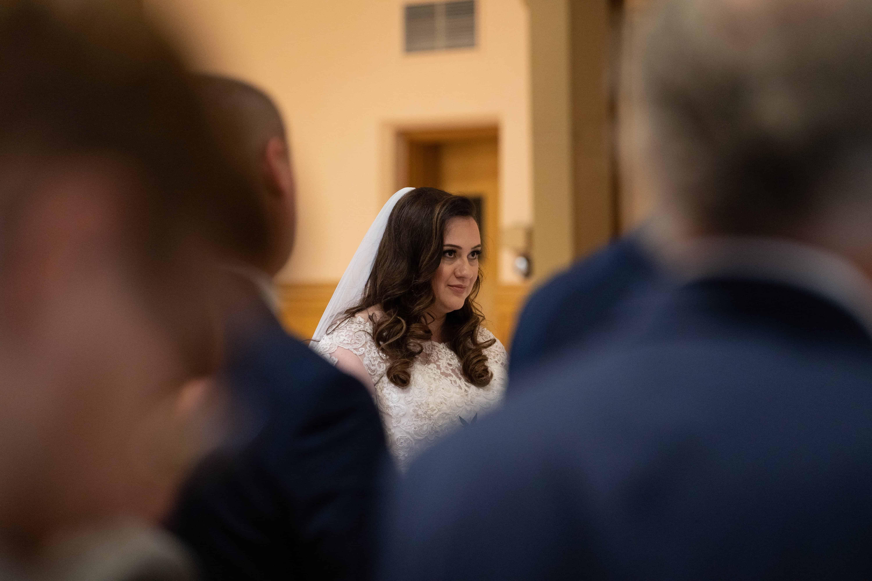 bride looking at groom at wedding at Church of Saint Clare