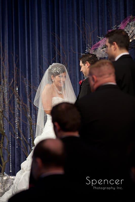 bride reacting to groom at wedding ceremony at Cornerstone Church Medina