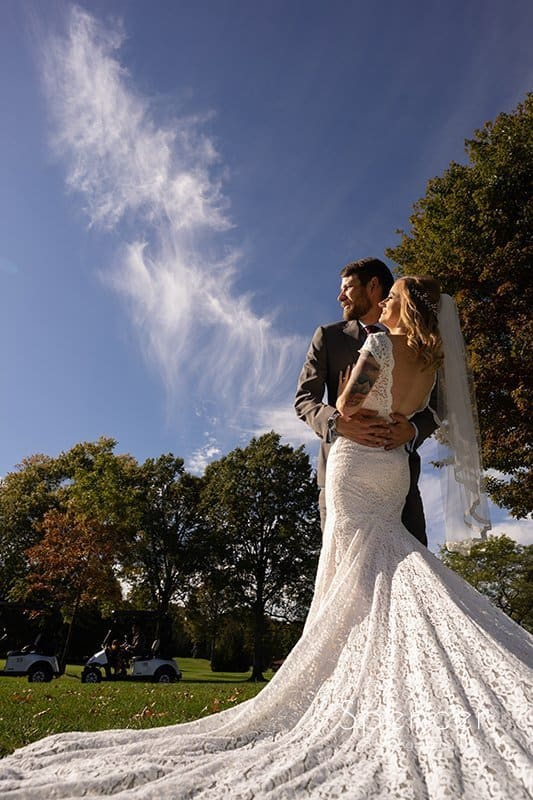 dramatic picture of bride's wedding dress at Firestone Country Club