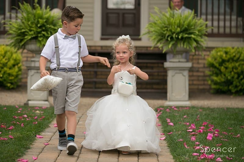 kids walking down aisle at wedding at Country Cottage and Gardens