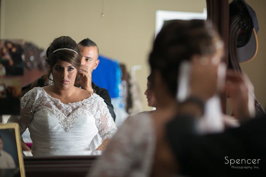 Muslim bride putting on wedding dress