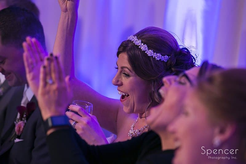 bride reacts to fathers speech at reception at Embassy Suites