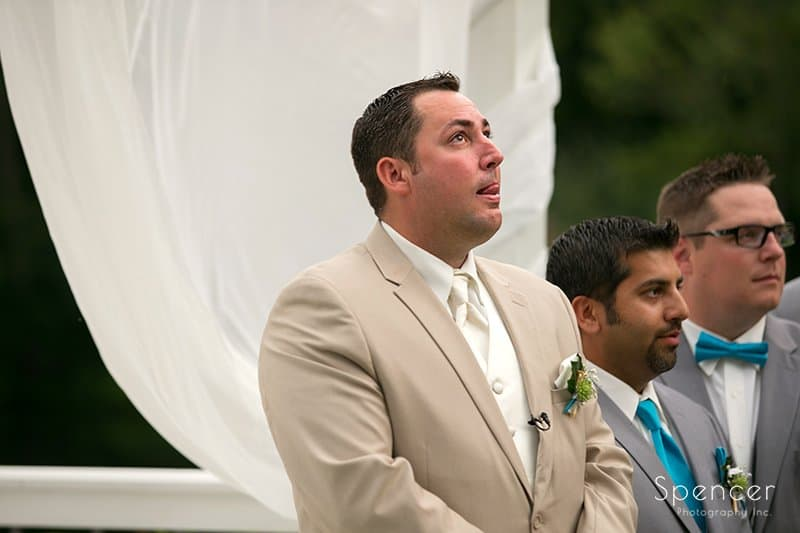 groom reacting to seeing bride at Country Cottage and Gardens wedding