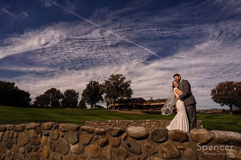 bride and groom hugging at Firestone wedding