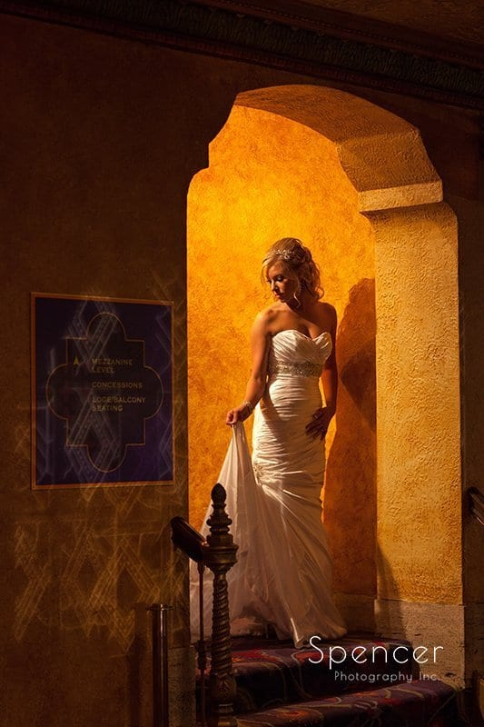 bride holding her dress at Akron Civic Theater