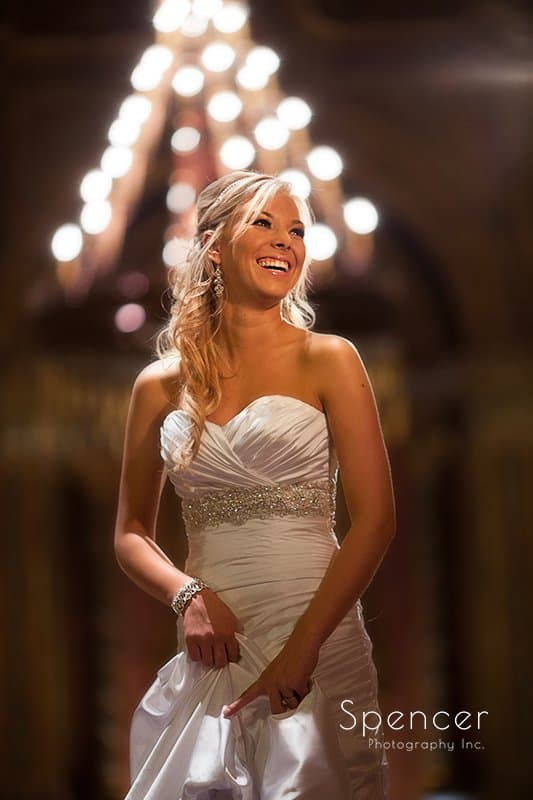 bride smiling in front of lights at Akron Civic Theater