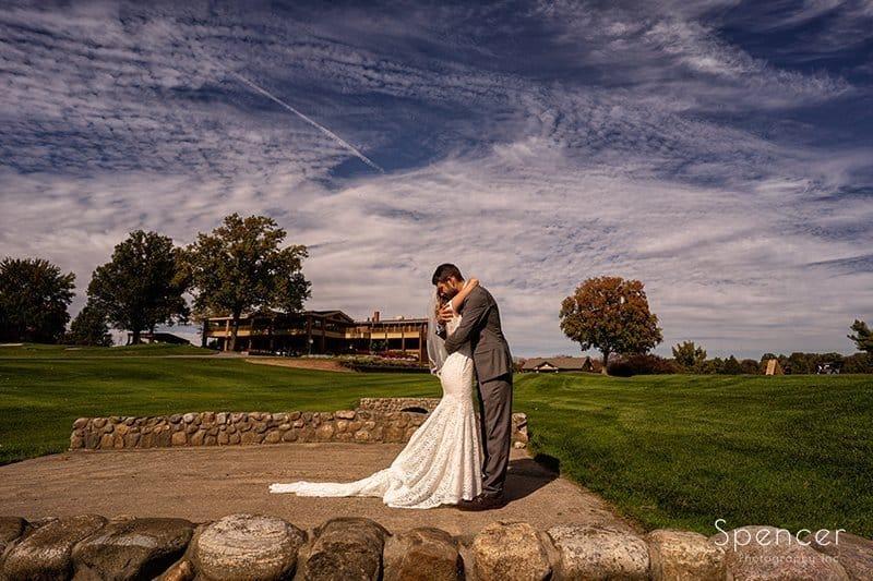 groom hugs bride at Firestone wedding