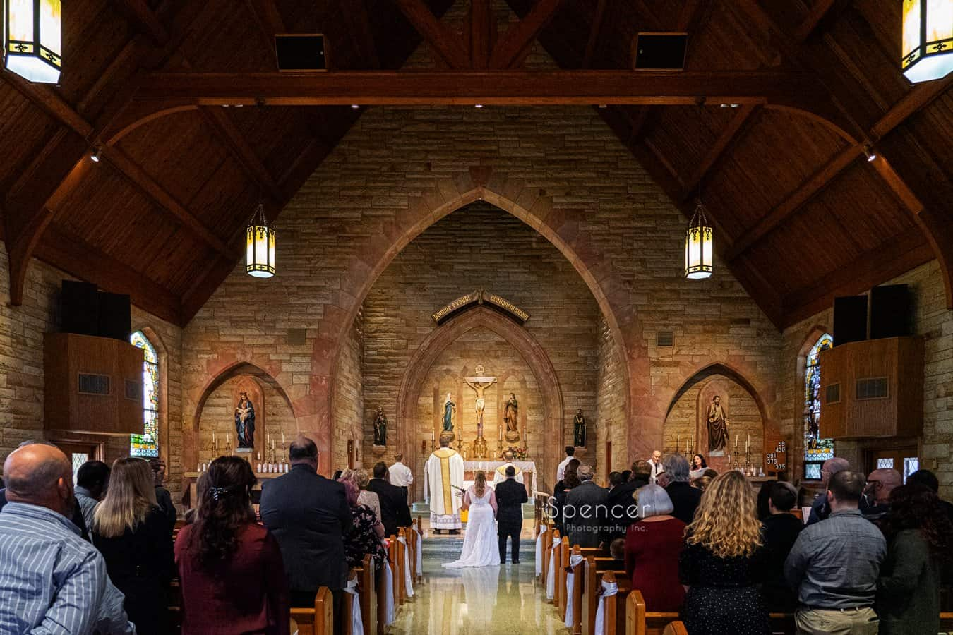 bride and groom at altar of Indiana wedding ceremony