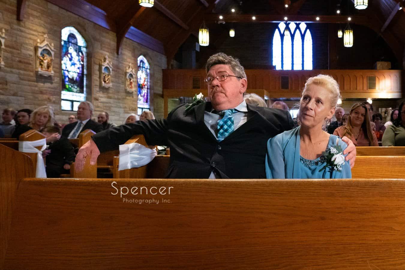 brides parents watching wedding ceremony in Indiana
