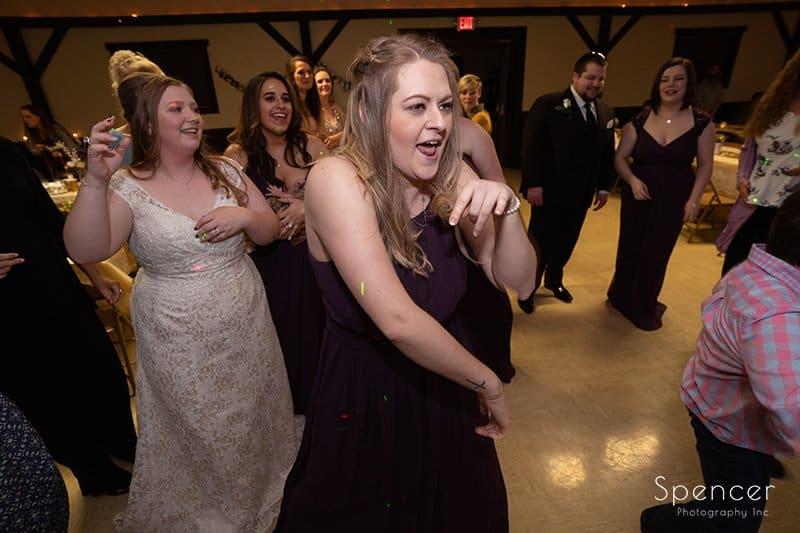 bridesmaid dancing at wedding reception in Indiana