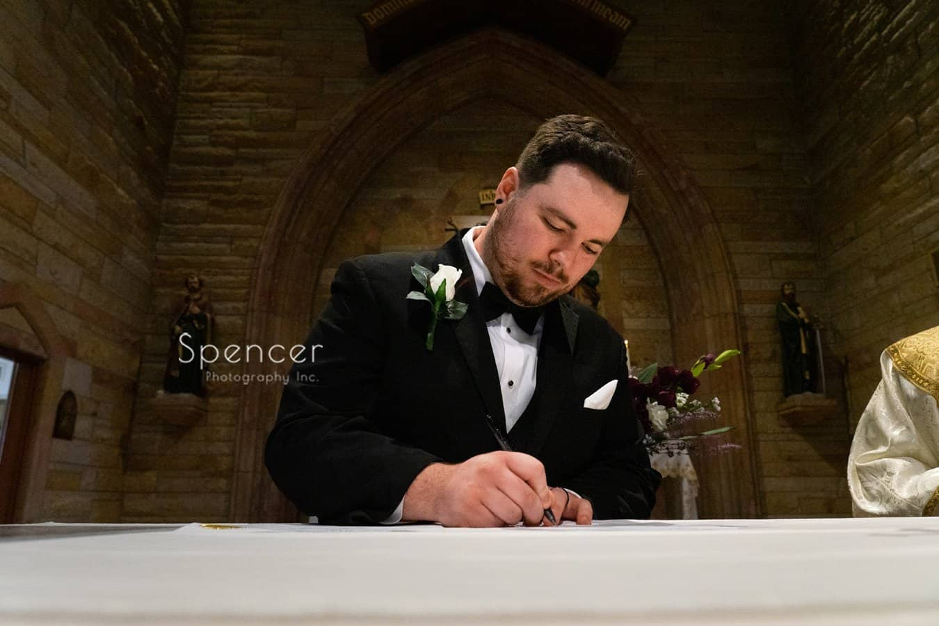 groom signing Indiana wedding license