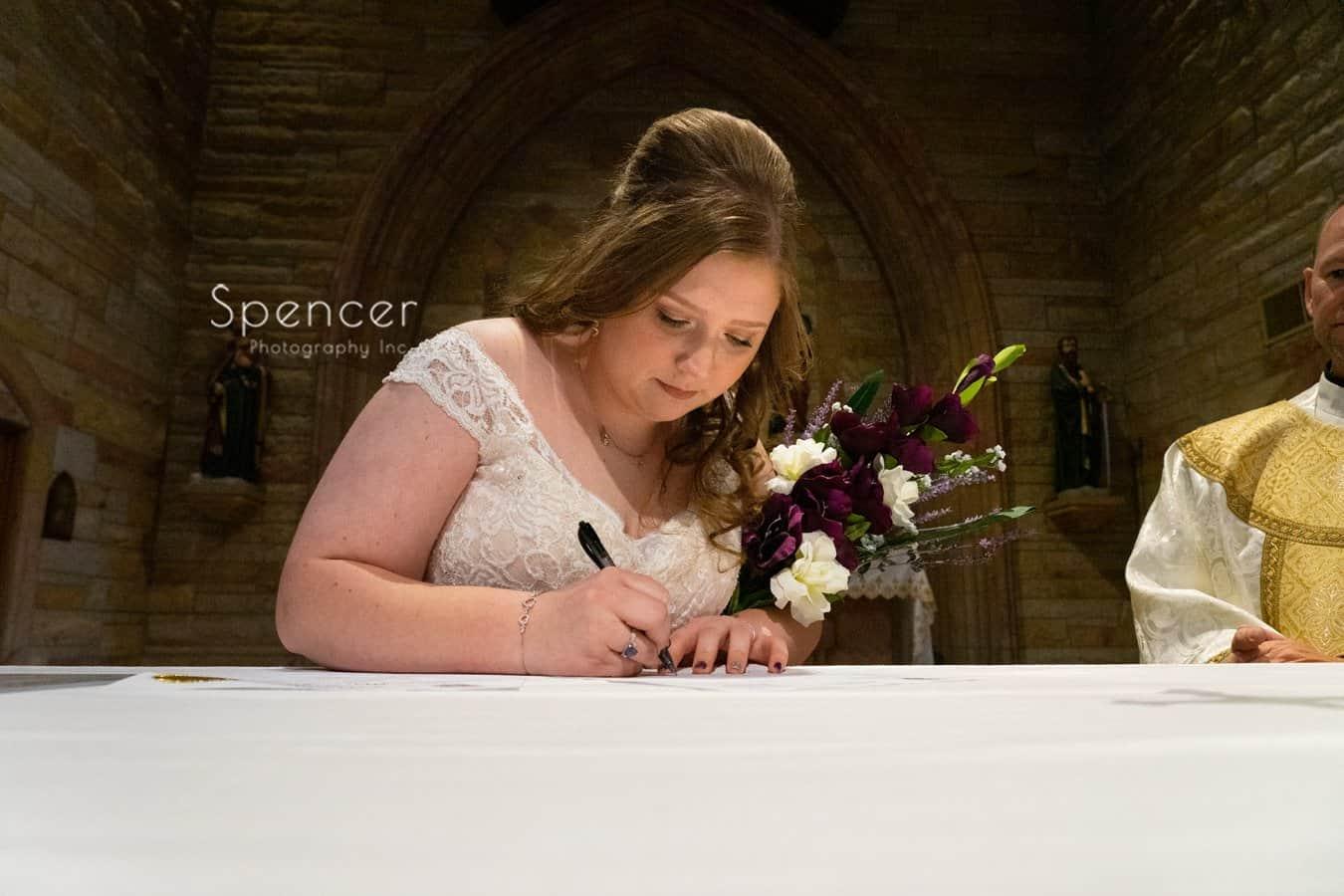 bride signing Indiana wedding license