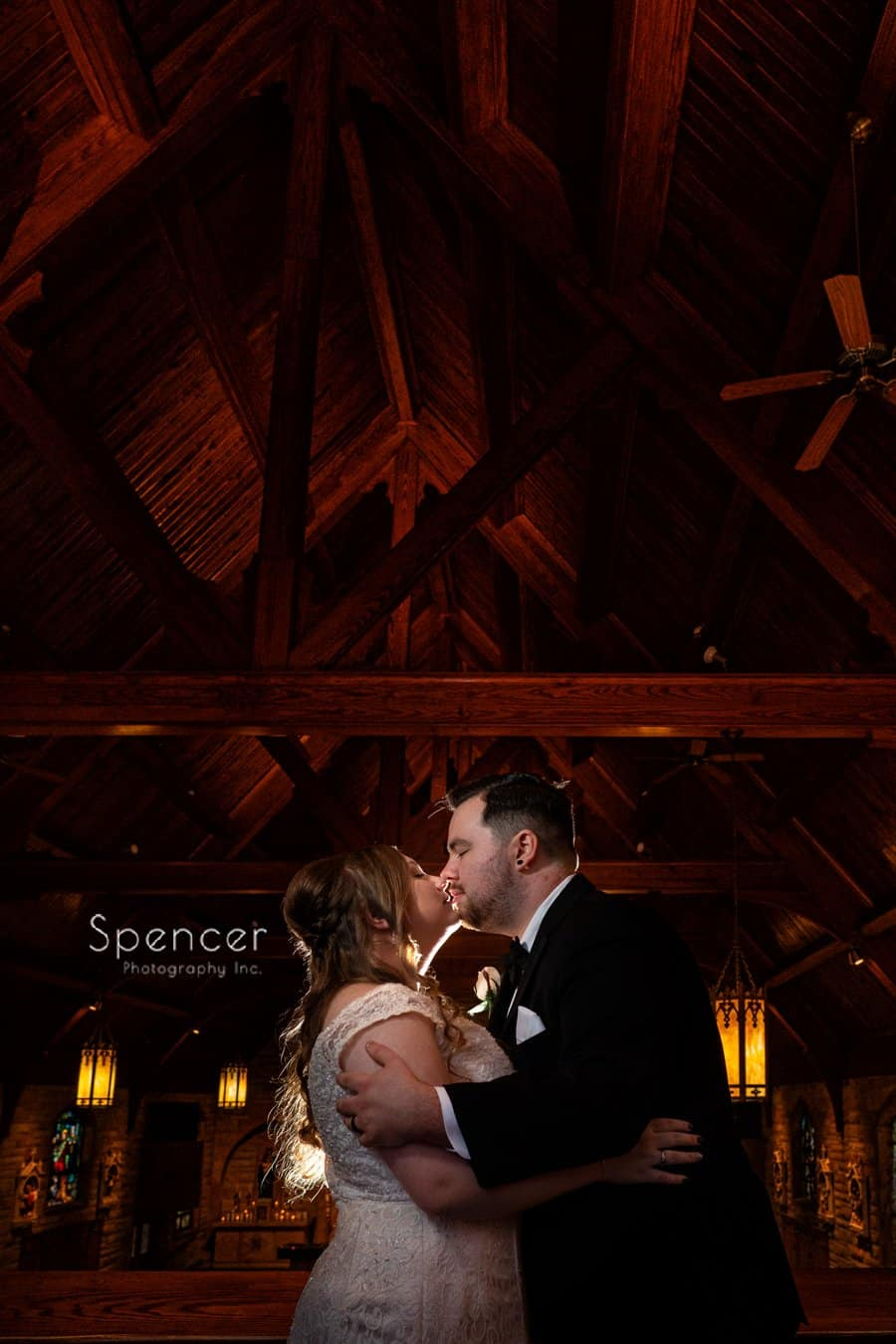 bride and groom kissing at saint peter and paul church