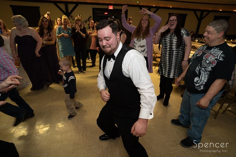 groom dancing at his wedding reception in Indiana