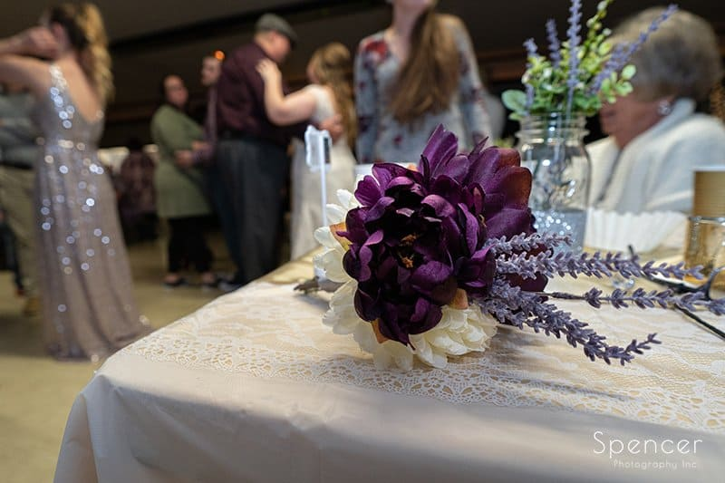 bridal bouquet sitting on reception table