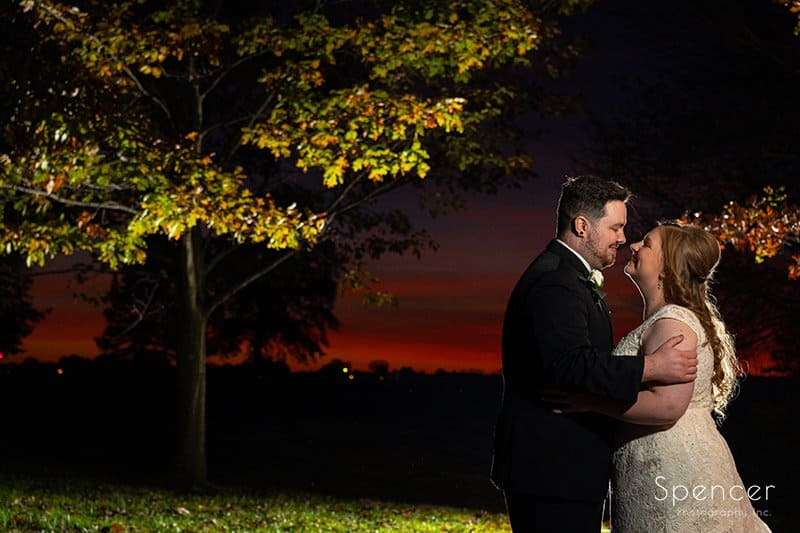 wedding picture of bride and groom at sunset