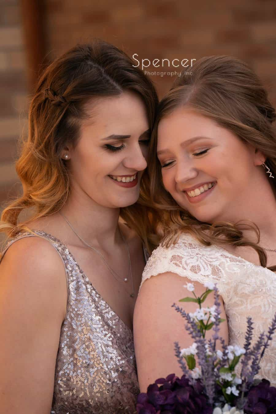 bride smiling with maid of honor