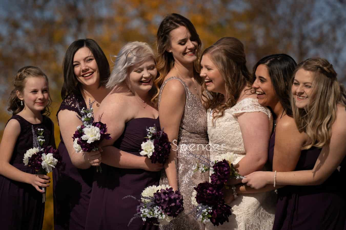 bridesmaids laughing with bride