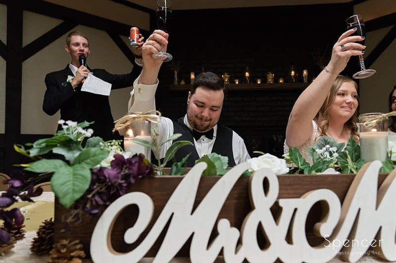 bride and groom toast to best man