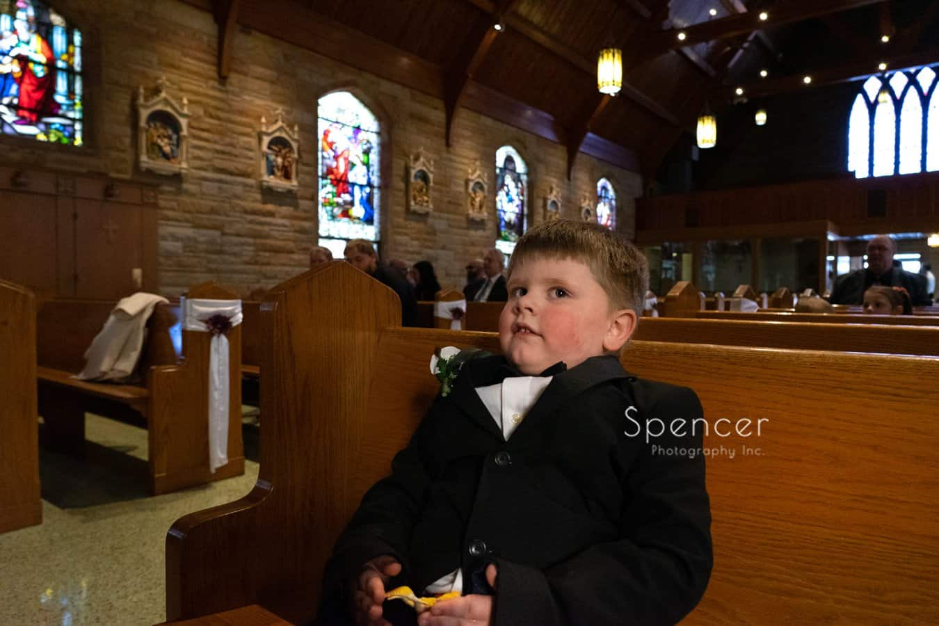 ring bearer waiting for Indiana wedding ceremony to begin