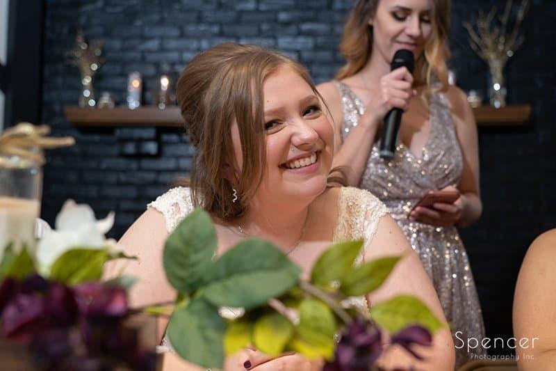 bride smiling at her wedding reception