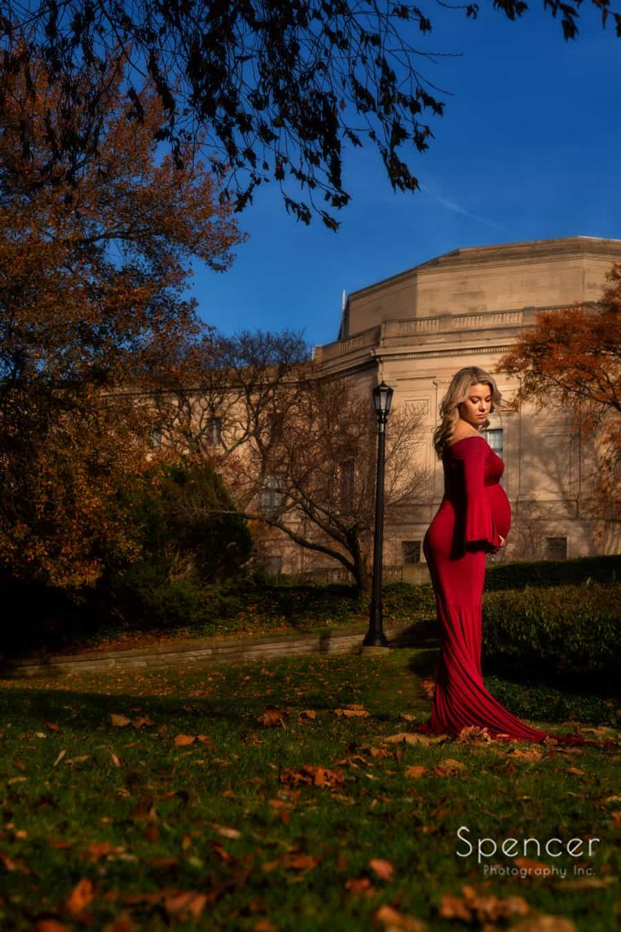 mom posing for maternity picture in front of Severance Hall Cleveland