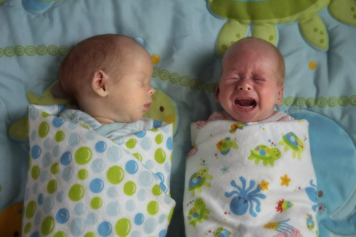 newborn picture of Clevelane twins one is crying