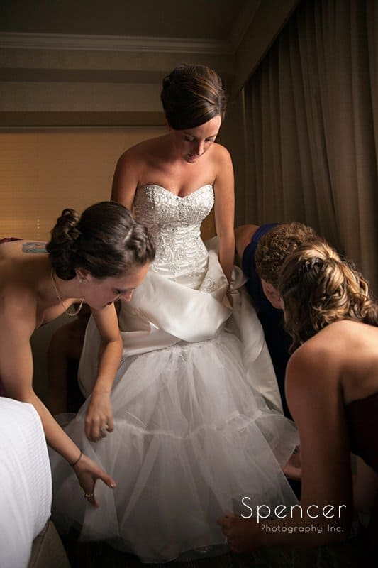 bride putting wedding shoes on at Montrose Zion Church