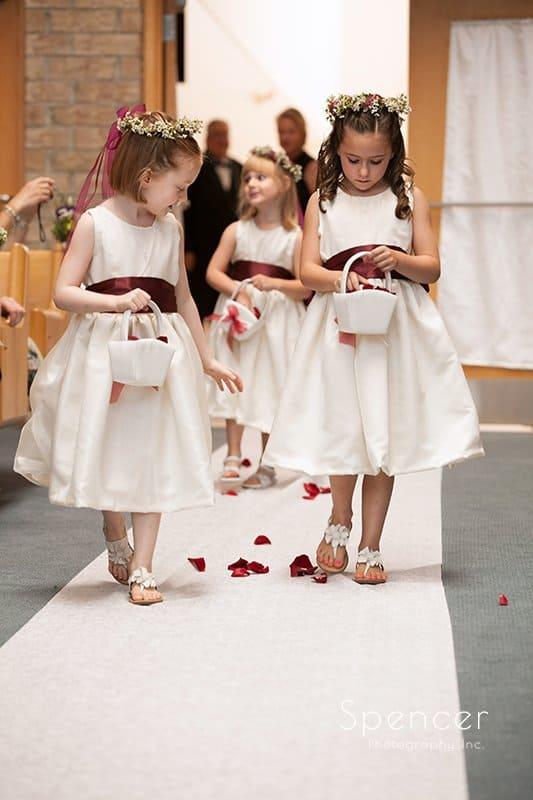 flower girls walking down wedding aisle at Montrose Zion Church
