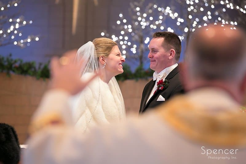 bride smiling at groom during christmas wedding at Holy Angels Church