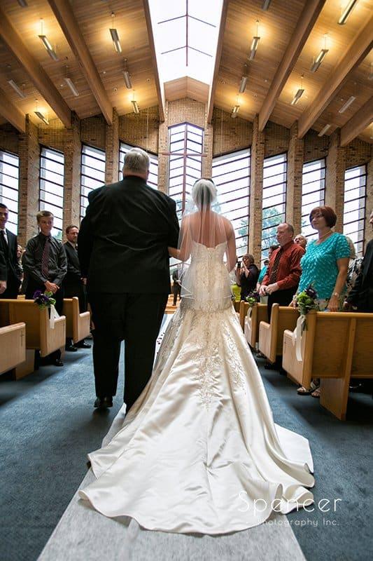 dad walking bride down aisle at Montrose Zion Church