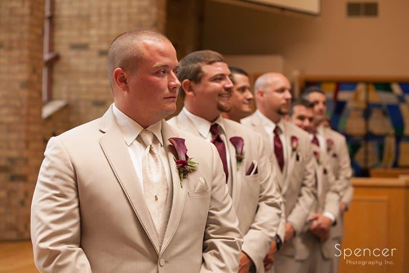 groom watching bride walk aisle at Montrose Zion Church