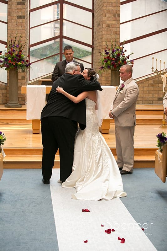 dad gives bride away at wedding ceremony