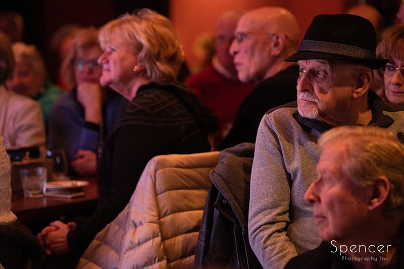 fan watching musicians at Brothers Lounge