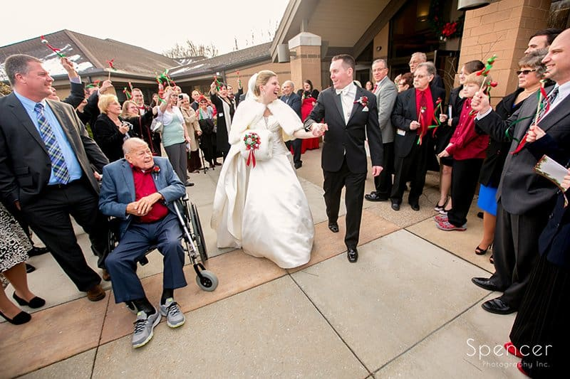 bride and groom exiting wedding ceremony at Holy Angels Church