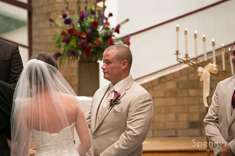 groom at altar at Montrose Zion Church in Montrose Ohio