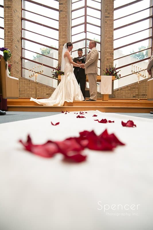 a pile of rose pedals in wedding aisle at Montrose Zion