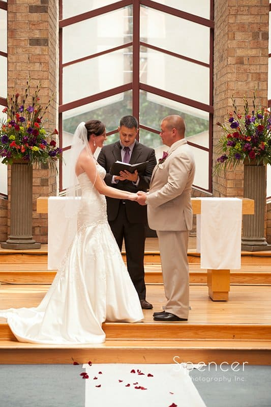 bride and groom at altar at Montrose Zion