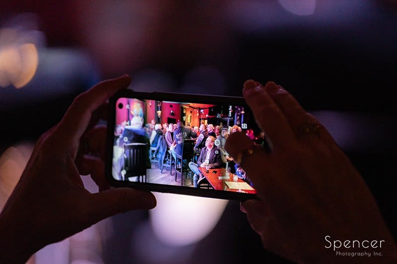 woman taking cellphone picture of band at Brothers Lounge Cleveland